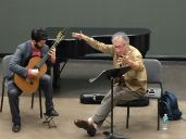 Alvaro Pierri conducting in a masterclass with an FSU guitarist